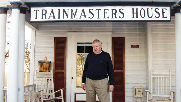Tim Hensley, proprietor of the Trainmaster's House bed and breakfast in Kenova, is seen on his home's porch.