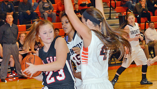 Ironton Lady Fighting Tigers' Jordan Hannan (4) and Lexie Barrier (15) apply defensive pressure to Coal Grove Lady Hornets' Lauren Crum (23). Ironton won 53-29. (Tony Shotsky of Southern Ohio Sports Photos)
