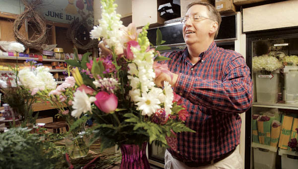 Tim Hackworth, owner of Touch of Grace, creates arrangements.