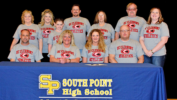 South Point Lady Pointers' volleyball standout Olivia Abner signed a letter-of-intent on Thursday to play at the University of Cincinnati-Clermont. Attending the signing ceremony were: seated from left to right, stepfather Shawn Burns, mother Mica Burns, Olivia, and father Nathan Abner; standing from left to right, grandmother Sylvia Bailey, aunt Theresa Bailey, cousin Luke Bailey, uncle Richie Bailey, grandmother Neda Abner, grandfather George Abner and stepmother Tonya Abner. (Kent Sanborn of Southern Ohio Sports Photos)