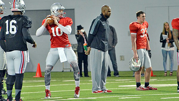 Red-shirt freshman quarterback Joe Burrow (10) from Athens High School sets up in spring practice workouts. Burrow will see action during a scrimmage on Saturday. (Photo Courtesy of Ohio State Buckeyes.com)