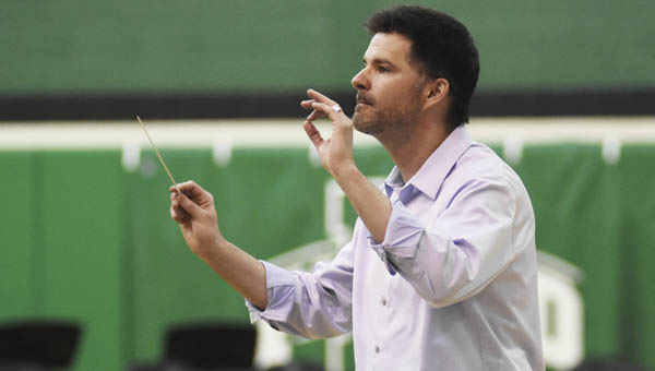 Conductor Jeff Gershman instructs students during practice for the All-County Band concert at Fairland High School.