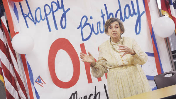 Hanging Rock president Jean Butler acts the role of Ohio's original First Lady Mary Tiffin during a special performance at Fairland West in recognition of Ohio's birthday.