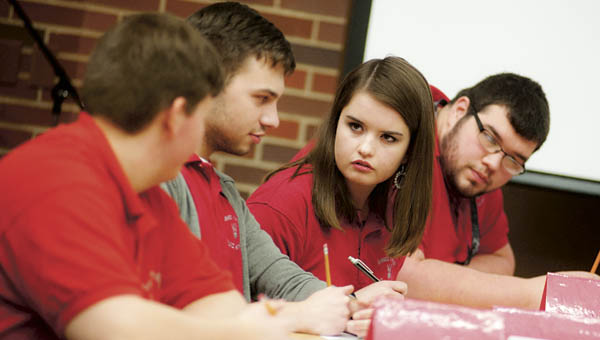 Pictured left to right, Colin Lybrand, Tanner Shephard, Felicity Jenkins and Nic Slack, of Symmes Valley High School, contemplate an answer.