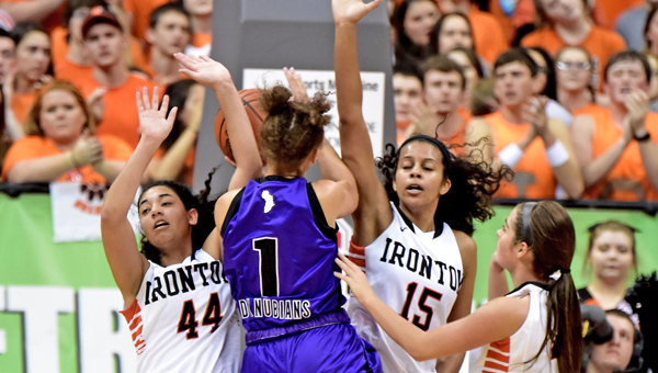 Ironton Lady Fighting Tigers' seniors Cheyenne Scott (44), Lexie Barrier (15) and Jordan Hannan converge on Africentric's Zharia Lenoir (1) during the Division III state semifinal game on Thursday. Ironton suffered its first loss of the season, 63-34. (Kent Sanborn of Southern Ohio Sports Photos)
