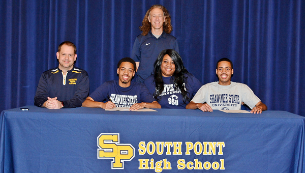 South Point Pointers' Trent and Trey Patterson signed letters of intent on Thursday to run track at Shawnee State University. Attending the signing ceremony were: sitting from left to right, South Point head coach Todd Wells, Trent Patterson, mother Melanee Howard and Trey Patterson; standing is Shawnee State head coach Eric Putnam. (Kent Sanborn of Southern Ohio Sports Photos)