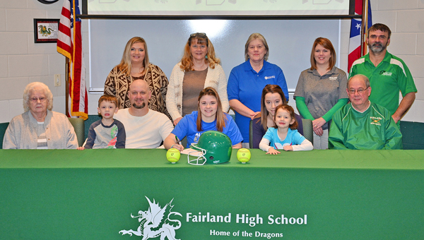 Fairland Lady Dragons' senior softball standout Allison Shepherd signed a letter-of-intent on Friday to attend Alice Lloyd College. Attending the signing ceremony were: seated from left to right, great-grandmother Marcella Haynes, father Derrick Shepherd with her brother Logan, Allison, step-mother Jo Shepherd and sister Dixie, and Fairalnd assistant coach Jim Bailey; standing from left to right, aunt Lori Shepherd, grandmother Kathy Shepherd, aunt Bonnie Lockhart, Fairland head coach Stacie Smithson and Fairland assistant coach Jason Morris. (Kent Sanborn of Southern Ohio Sports Photos)