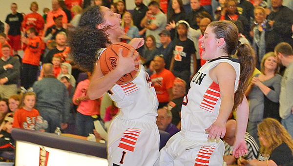 Ironton Lady FIghting Tigers' Cheyenne Scott (left) and Sydney Webb (right) jump for joy after winning the Division III regional basketball championship on Saturday and earning a berth in the state tournament on Thursday. Ironton rallied to beat West Lafayette Ridgewood 46-43 in the regional title game. (Kent Sanborn of Southern Ohio Sports Photos)