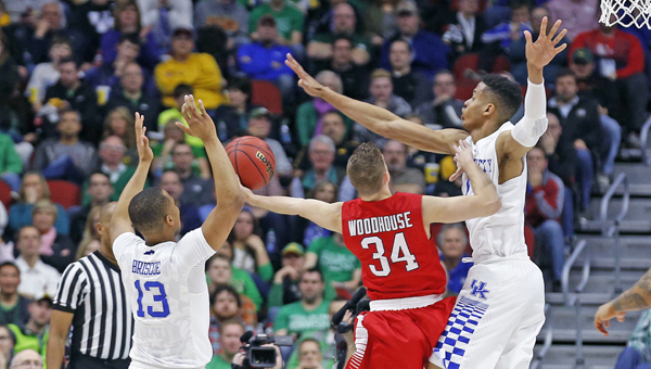 Kentucky's Skal Labissiere (1) blocks a shot by Stony Brook's Lucas Woodhouse (34) during the first half in the first round of the NCAA Tournament at the Wells Fargo Arena in Des Moines, Iowa, on Thursday. Kentucky advanced, 85-57 and will play Indiana at 5:15 p.m. on Saturday. (Charles Bertram/Lexington Herald-Leader/TNS)