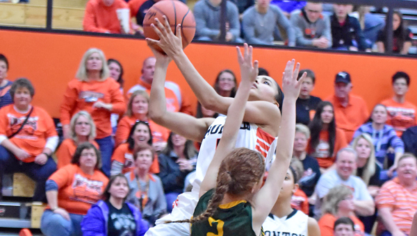 Ironton Lady Fighting Tigers' sophomore guard Lexie Wise (with ball) makes a driving layup to start the fourth quarter during Saturday's 49-36 win over North Adams in the Division III district championship game. Ironton plays Alexander at 6:15 p.m. on Wednesday at Logan High School. (Kent Sanborn of Southern Ohio Sports Photos)