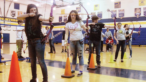 South Point High School students participate in an archery class Friday afternoon. The equipment needed was sponsored though a grant from the Ohio Division of Wildlife.