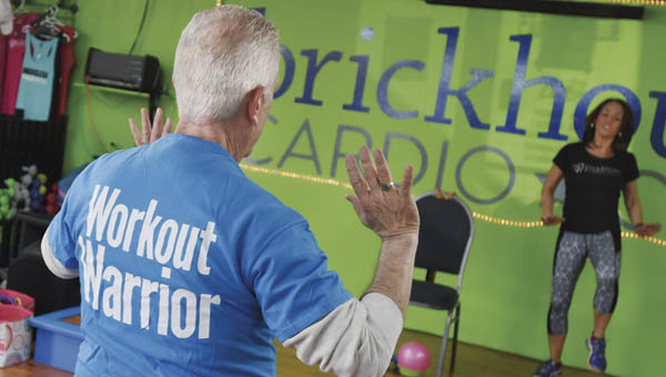 Congressman Bill Johnson takes part in a SilverSneakers class Wednesday at Brickhouse Cardio Club in Poctorville.