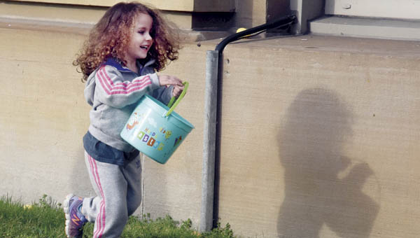 Three-year-old Deja Jenkins hunts for eggs during the annual egg hunt event in Ironton Tuesday.
