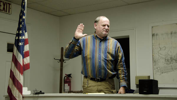 Dennis Gibson swears in at the Chesapeake Village Council meeting hearing Tuesday evening.