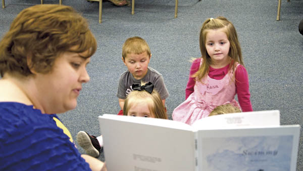Library assistant Jan Gullett reads to children during Preschool Story Time at the Briggs-Lawrence Public Library in Ironton on Monday.