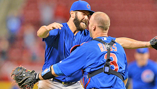 Chicago Cubs' pitcher Jake Arrieta (left) and catcher David Ross celebrate after Arrieta threw a no-hitter on Thursday against the Cincinnati Reds in a 16-0 rout. (Photo Courtesy of The Cincinnati Reds.com)