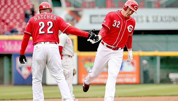 Cincinnati Reds' outfielder Jay Bruce (32) is congratulated by third base coach Billy Hatcher (22) after hitting the first of two home runs during Thursday's 10-6 win over the Philadelphia Phillies. (Photo Courtesy of The Cincinnati Reds.com)