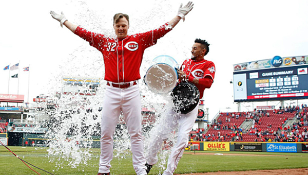 Billy Hamilton drenches Jay Bruce (32) with a water cooler after Bruce's RBI triple in the ninth inning gave the Cincinnati Reds a 2-1 win over the Pittsburgh Pirates on Sunday. (Photo Courtesy of The Cincinnati Reds.com)
