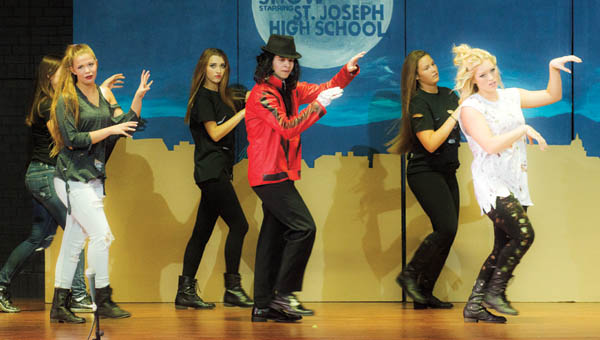 """Students perform """"Thriller"""" with favorite characters from Scooby Doo and Ghost Busters as part of the Variety Show event at St. Joseph High School."""