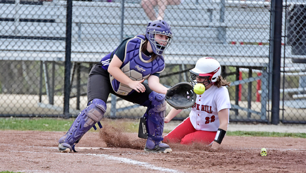 Rock Hill Redwomen's Kelsey Olderman (22) slides into home safely ahead of the tag of Chesapeake Lady Panthers' catcher Kelsey Huff during Wednesday's Ohio Valley Conference game. Rock Hill beat the Lady Panthers 12-5. (Kent Sanborn of Southern Ohio Sports Photos)