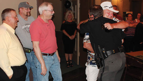Lawrence County Sheriff Jeff Lawless greets Sgt. Randy Goodall, who just retired from the sheriff's office, at his retirement party Thursday at the Ironton Elks.