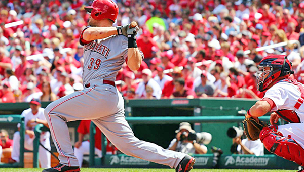 Cincinnati Reds' catcher Devin Mesoraco hits a run-scoring single in the fourth inning during Sunday's game. The Reds lost to the St. Louis Cardinals 4-3. (Photo Courtesy of The Cincinnati Reds.com)