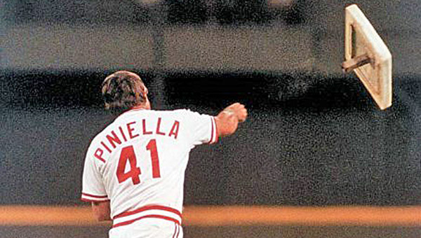 Lou Piniella throws first base during one of his tirades over a bad call when he was the Reds' manager in the 1990 World Championship season. He is this year's Grand Marshal. (Courtesy of the Cincinnati Reds.com)