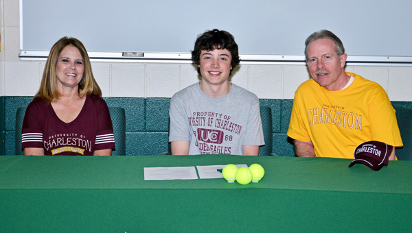 Fairland Dragons' senior Jason Prince signed a letter-of-intent on Friday to play tennis at the University of Charleston. Among those attending the ceremony were, from left right, mother Pam, Jason and father Rick. (Kent Sanborn of Southern Ohio Sports Photos)