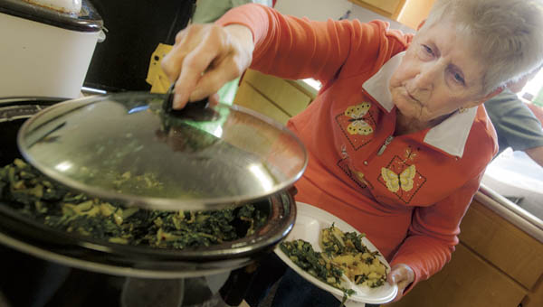 Mary Cooper serves up a plate full of ramps during the annual ramp dinner Saturday at the Proctorville VFW 6878.