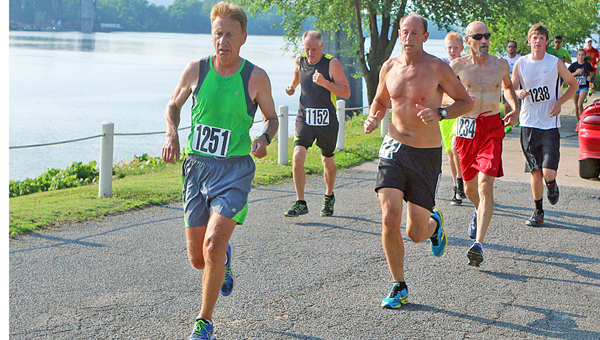 Runners enjoy the scenic view of the annual Run By The River 5K event. This year's even is scheduled for June 11. (Tim Gearhart of Tim's News & Novelties, Park Ave. in Ironton)