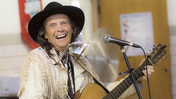 Artist Steve Free performs for students Tuesday at St. Lawrence School in Ironton. Free has performed all over the United States and Canada and has been featured on PBS, TNN and NPR.