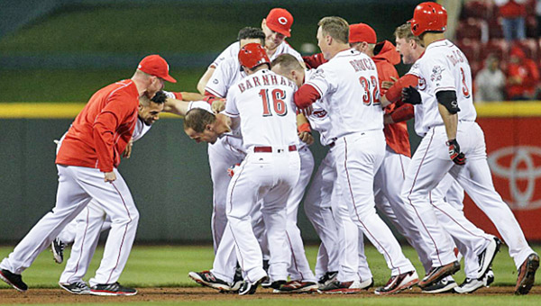 Cincinnati outfielder Scott Schebler is mobbed by teammates after his game-winning double in the bottom of the ninth gave the Reds a 3-2 win over Philadelphia on Wednesday. (Photo Courtesy of The Cincinnati Reds.com)