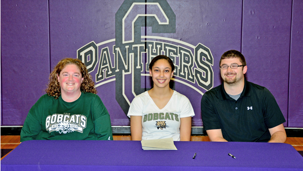 Chesapeake Lady Panthers' senior track standout Atiya Spaulding signed a letter-of-intent to run track for Ohio University on Wednesday. Attending the scholarship signing were: seated left to right, mother Shelley Ransbottom, Atiya, and uncle Brent Ransbottom. (Kent Sanborn of Southern Ohio Sports Photos)