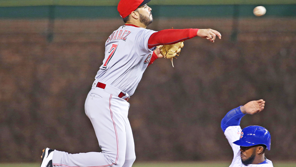 Cincinnati Reds third baseman Eugenio Suarez (7) throws to first base after forcing out the Chicago Cubs' Dexter Fowler at second base in the third inning at Wrigley Field in Chicago on Thursday. The Reds lost to the Cubs 8-1. ( John J. Kim/Chicago Tribune/MCT Direct)