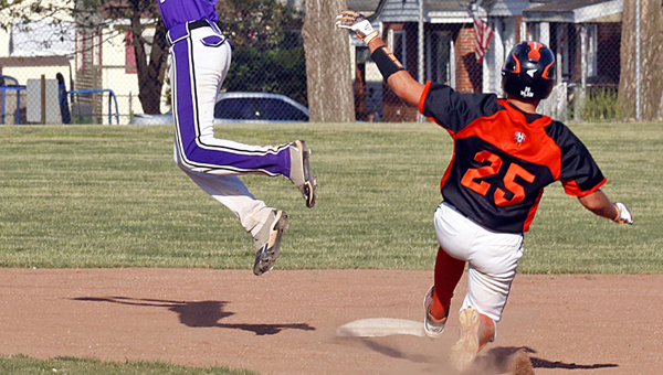 Ironton Fighting TIgers' Dane Wilson slides safely into second base as Chesapeake's Josh Hansen leaps high into the air to catch the throw. Ironton won 4-2. (Tim Gearhart of Tim's News & Novelties, Park Ave. in Ironton)
