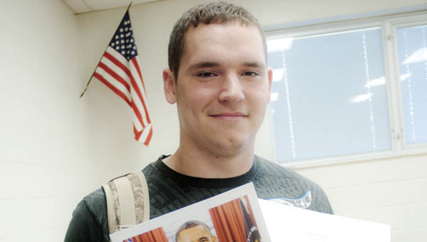 Junior Chase Johnson, at Dawson-Bryant High School, shows off a photograph and written letter sent by President Obama.