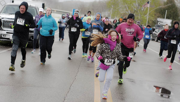 Runners take off at the start of the Sixth Annual 5K for Developmental Disabilities Awareness at The Point industrial park on Saturday morning.