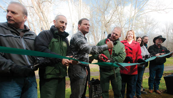 Community members gather for a ribbon cutting ceremony of the new Balancing Rock Trail Friday morning at Lake Vesuvius.