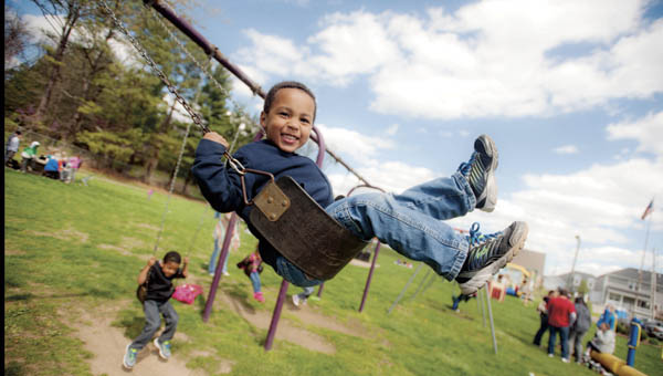 Four-year-old Nikeli Whimbush has fun playing on the swings during sober family fun day event Saturday at Chesapeake Park. The event was hosted by Riverside Recovery Services.
