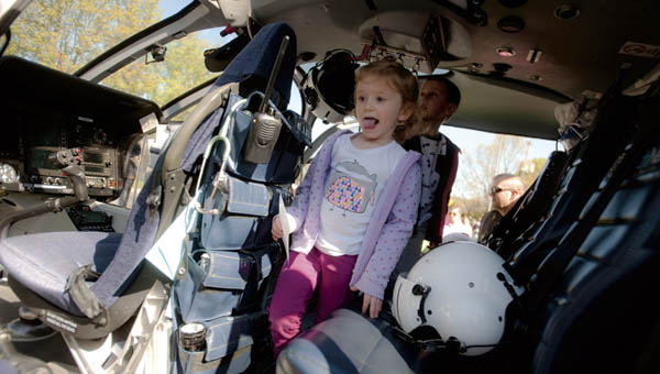 Mayla Wilson makes her way through the HealthNet Aeromedical Services helicopter as part of Transportation Day at Lawrence County Early Childhood Center in South Point Wednesday.