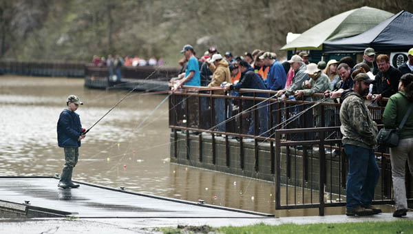 Area residents  gather on the boardwalks at Lake Vesuvius for the annual Wheelin' Sportsmen Fishing event in 2015.