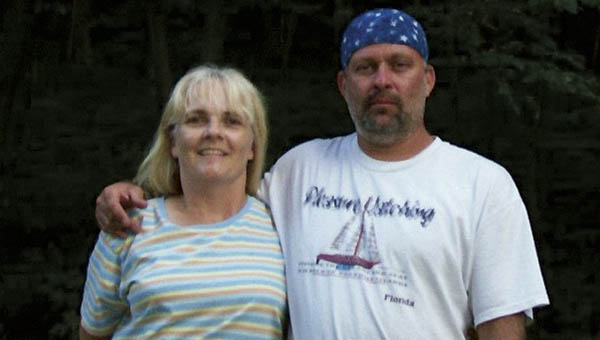 Paula Lawson-Woycheese is seen with her ex-husband James Allen Lawson in this 2011 photo. After last being seen in South Point on April 28, 2012, he was found dead from a gunshot wound in Mason County, West Virginia three and a half weeks later.  His murder remains unsolved.