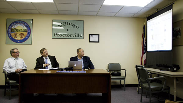 Proctorville fiscal officer Darrell Legg and Eric Ochmanek, the deputy chief of staff for Ohio Treasurer Josh Mandel, and treasurer's office public liaison Josh Burton give a demonstration of the Village of Proctorville online checkbook at Proctorville Village Hall on Monday.