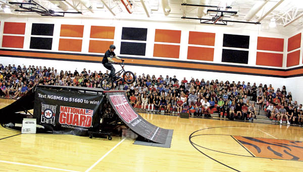 BMX riders performed stunts Monday morning in the Ironton High School gymnasium.