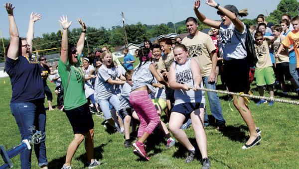 Burlington Elementary fifth graders win final tug of war match and the trophy as they face off with South Point Elementary during Field Day on Tuesday.