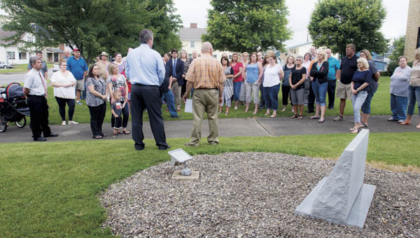 Randy Thompson, right, and Terry Porter, right, address members of Lawrence County Department of Jobs and Family Services during their memorial unveiling Thursday. The memorial shows the names of those employees they lost.
