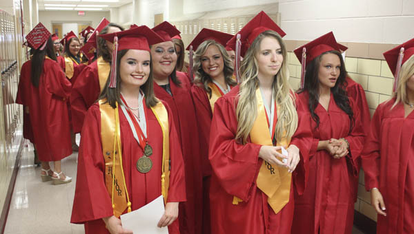A group of Symmes Valley High School senior girls wait for graduation to begin Friday evening at the high school.
