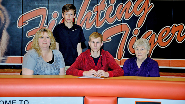 Ironton Fighting Tigers' senior wingman Travis Carey signed a letter-of-intent to play basketball with the University of Rio Grande. Attending the signing ceremony were: from left to right, mother Jenni Carey, brother Trevor, Travis and grandmother Judy Carey. (Kent Sanborn of Southern Ohio Sports Photos)