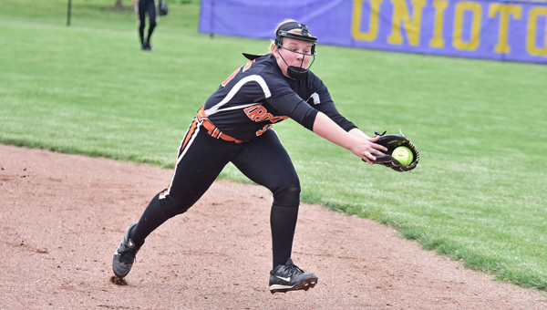 Ironton Lady Fighting Tigers' shortstop Shay Cox stretches to make the catch of line drive during Tuesday's Division III district semifinal game. Ironton gave up seven unearned runs in an 8-3 loss to the Alexander Lady Spartans. (Kent Sanborn of Southern Ohio Sports Photos)