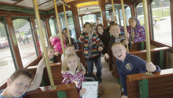 Students tour Huntington's special trolley bus as part of Vehicle Day at Burlington Elementary School.